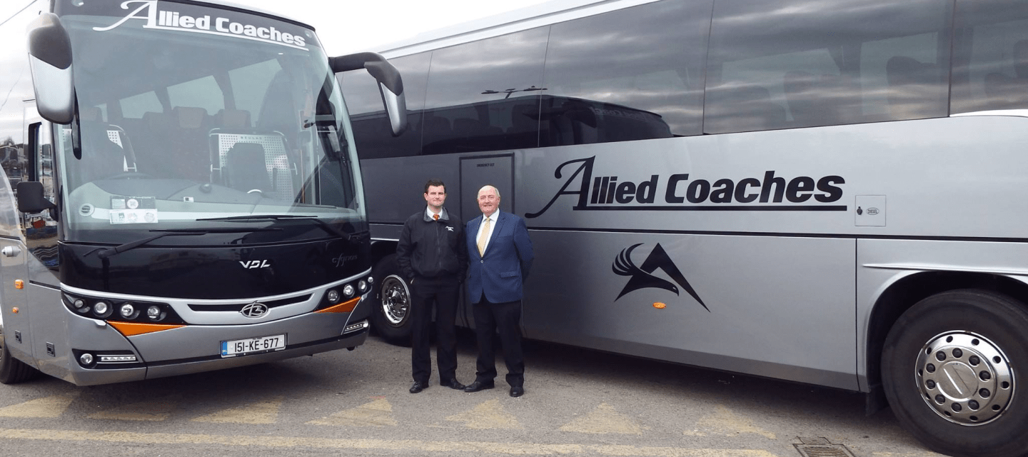 Allied Coaches Professional Drivers Standing in Front of Coaches Dublin
